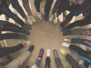 young people together in a circle